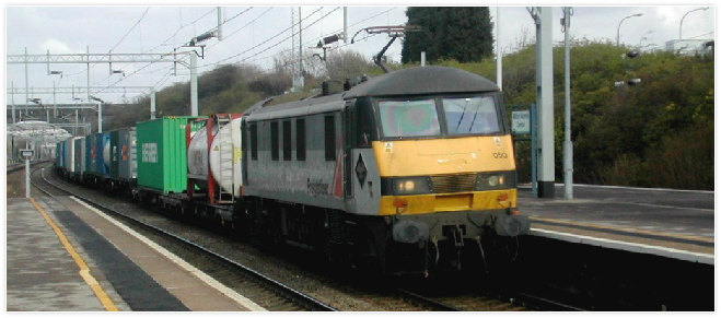 90050 heads south through Milton Keynes on a container train in April 2004 - not long afterwards this photo was taken, the loco was stored with fire damage